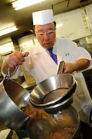 "Tamura Takashi, owner of ""Tsukiji Tamura"" Japanese restaurant preparing dashi using katsuobushi, Tokyo, Japan, July 17, 2009. Tsukiji Tamura is one of the best known ""ryotei"" traditional Japanese restaurants in Tokyo. Owner Tamura prepares dashi using two types of katsuobushi plus kombu from Hakodate in Hokkaido."