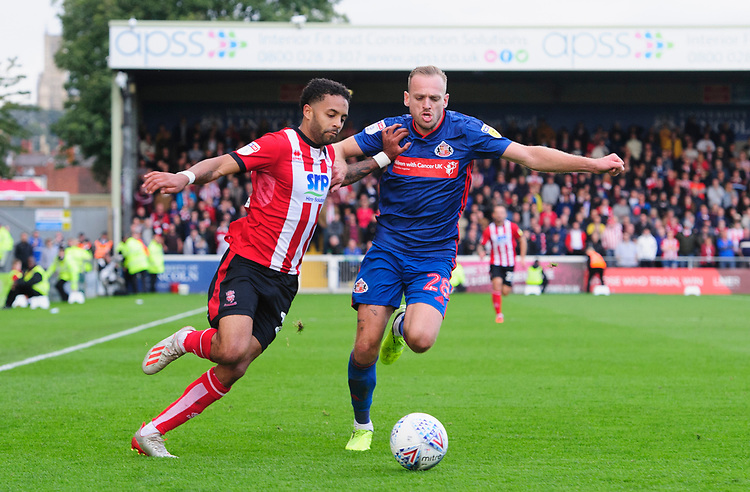 Lincoln City's Bruno Andrade vies for possession with Sunderland's Laurens De Bock<br /> <br /> Photographer Chris Vaughan/CameraSport<br /> <br /> The EFL Sky Bet League One - Lincoln City v Sunderland - Saturday 5th October 2019 - Sincil Bank - Lincoln<br /> <br /> World Copyright © 2019 CameraSport. All rights reserved. 43 Linden Ave. Countesthorpe. Leicester. England. LE8 5PG - Tel: +44 (0) 116 277 4147 - admin@camerasport.com - www.camerasport.com