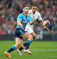Luca Morisi of Italy passes the ball. RBS Six Nations match between England and Italy on February 14, 2015 at Twickenham Stadium in London, England. Photo by: Patrick Khachfe / Onside Images