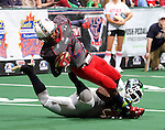 SIOUX FALLS, SD - MAY 4:  Mike Tatum #23 from the Sioux Falls Storm is tripped up by Carl Gettis #22 from the Nebraska Danger in the second quarter of their game Saturday night at the Sioux Falls Arena. (Photo by Dave Eggen/Inertia)