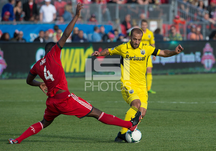 18 May 2013: Toronto FC defender Doneil Henry #4 and Columbus Crew forward Federico Higuain #33 in action during an MLS game between the Columbus Crew and Toronto FC at BMO Field in Toronto, Ontario Canada..The Columbus Crew won 1-0...