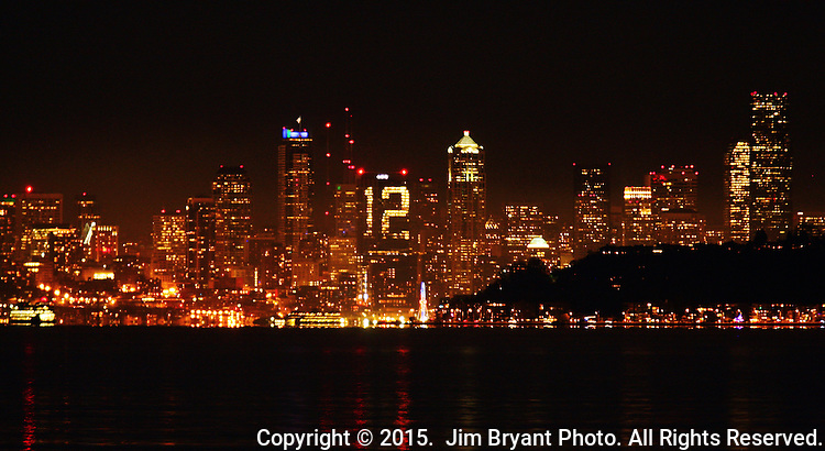 Lights in a building in the Seattle skyline are ablaze with the numeral 12 for the 12th man as the  Seahawks take on the Carolina Panthers in the first round of tomorrows NFC Western Division Playoffs at CenturyLink Field in Seattle, Washington on January 09, 2015.  Photo by ©2015. Jim Bryant Photo. All Rights Reserved.