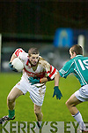 Damien Wallace (St Brendans) ploughs through Ballincollig defender.Patrick Kellys challenge during the Credit Union Duhallow U/21.Invitational Cup final in Knocknagree last Saturday night.