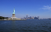 New York, USA. Statue of Liberty on Liberty Island with Manhattan skyline including twin towers of World Trade Centre behind.