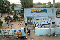 Local residents fill up their cans from the iJal station at the Medak District Hospital in Medak, Telangana, India.