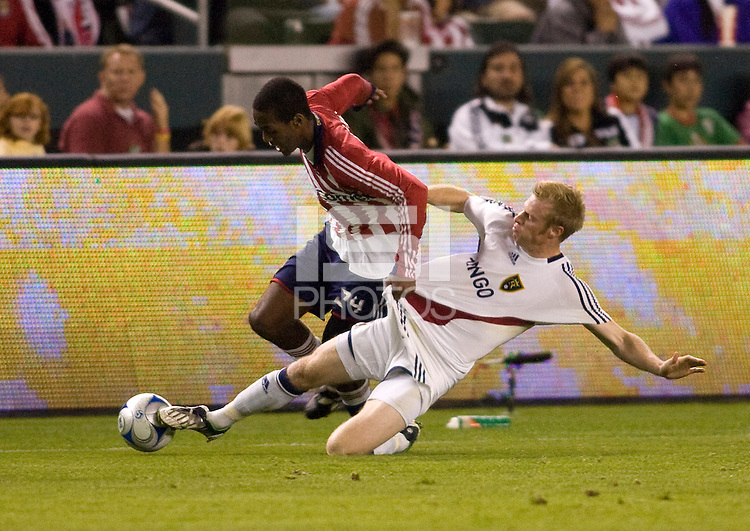 Real Salt Lake's Nat Borchers tackles Chivas USA's Atiba Harris. Real Salt Lake and Chivas USA played to a 2-2 draw in a MLS first round Western Conference playoff match. RSL advances on from aggregate total score at Home Depot Center stadium in Carson, California on Saturday November 8, 2008. Photo by Michael Janosz/isiphotos.com