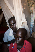 "Uganda - Imvepi Reception Center - Vicky Achimo (left), 29, and Jimmy Oyet (right), 25, are two siblings from Omeo. When their village was attacked by an armed group in March 2017 the two ran in opposite directions. Oyet arrived at Palorinya refugee camp on the same month and was assigned to a foster family. He was able to reunite with her sister only at the end of September, after she was traced in an adjoining refugee camp. Today, Oyet lives with his sister's family in Imvepi. ""We never lost hope of finding each other"", he says proudly."