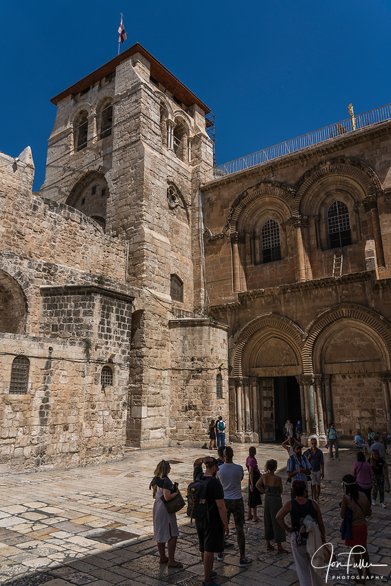 The 12th Century Crusader bell tower and the facade of the Church of the Holy Sepulchre in the Christian Quarter of the Old City of Jerusalem.  The Old City of Jerusalem and its Walls is a UNESCO World Heritage Site.  This church was built over the site believed by many to be location of the death and burial of Jesus Christ.  Below the window at right is the Immovable Ladder.