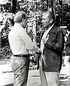 United Stats President Jimmy Carter, left, and President Anwar Sadat, right, shake hands as the Egypt-Israel Summit comes to an end at Camp David, the presidential retreat near Thurmont, Maryland on September 17, 1978..Credit: White House via CNP