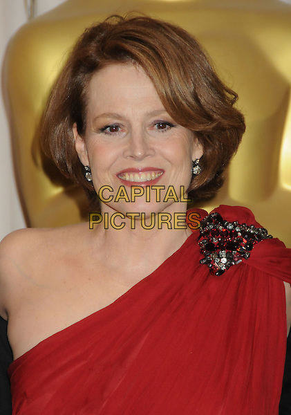 SIGOURNEY WEAVER .82nd Annual Academy Awards held at the Kodak Theatre, Hollywood, California, USA..March 7th, 2010.oscars headshot portrait brooch gold red one shoulder .CAP/ADM/BP.©Byron Purvis/AdMedia/Capital Pictures.