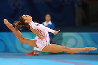 August 23, 2008; Beijing, China; Rhythmic gymnast Almudena Cid of Cid split leaps with ribbon on way to placing 8th in the All-Around final at 2008 Beijing Olympics. Almudena's 4th Olympics!.(©) Copyright 2008 Tom Theobald