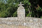 Old stone Christian cross on bridge, Garganta la Olla, La Vera, Extremadura, Spain