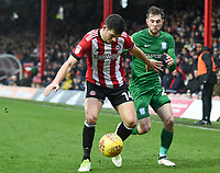 Preston's Tom Barkhuizen battles with Brentford's John Egans<br /> <br /> Photographer Jonathan Hobley/CameraSport<br /> <br /> The EFL Sky Bet Championship - Brentford v Preston North End - Saturday 10th February 2018 - Griffin Park - Brentford<br /> <br /> World Copyright &copy; 2018 CameraSport. All rights reserved. 43 Linden Ave. Countesthorpe. Leicester. England. LE8 5PG - Tel: +44 (0) 116 277 4147 - admin@camerasport.com - www.camerasport.com