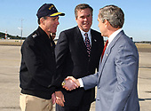 """Naval Station Mayport, Jacksonville, Fla. (Feb. 13, 2003) -- Admiral Robert J. Natter, Commander, U.S. Atlantic Fleet, and Florida Governor Jeb Bush, greet President George W. Bush upon his arrival aboard the Naval Station. President Bush later visited with Sailors and their families, thanking them for their sacrifices and the continuing effort with the global war on terror.  """"The United States Navy carries the might and the mission of America to the farthest parts of the world,"""" the President said. <br /> Mandatory Credit: Chuck Hill - US Navy via CNP"""