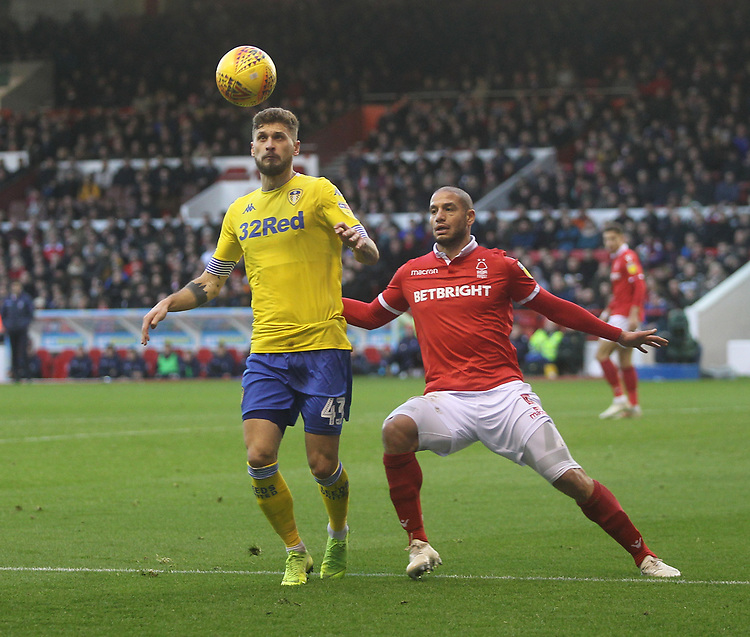 Leeds United's Mateusz Klich in action with Nottingham Forest's Adlène Guédioura<br /> <br /> Photographer Mick Walker/CameraSport<br /> <br /> The EFL Sky Bet Championship - Nottingham Forest v Leeds United - Tuesday 1st January 2019 - The City Ground - Nottingham<br /> <br /> World Copyright © 2019 CameraSport. All rights reserved. 43 Linden Ave. Countesthorpe. Leicester. England. LE8 5PG - Tel: +44 (0) 116 277 4147 - admin@camerasport.com - www.camerasport.com