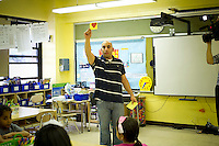 Teacher Mr. Mohamed Mamdouh displays a flashcard  to the students. First and second graders learn Arabic at P.S. 368-Hamilton Heights School in Harlem in New York on Wednesday, May 23, 2012. The program is the first at the K-5 school level in New York City Public Schools.  © Frances M. Roberts)