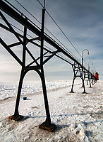The South Haven, Michigan Pierhead Light and Catwalk sits idle in winter, Allegan County, Michigan
