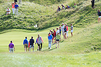 Pat Murray (Limerick) walks up the 13th after getting an Albatross - Hole in 1 during Round 2 of The South of Ireland in Lahinch Golf Club on Sunday 27th July 2014.<br /> Picture:  Thos Caffrey / www.golffile.ie