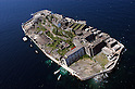 Hashima, Nagasaki, Japan. Also known as Gunkanjima (battleship island), it used to have coal mines and housed over 4,000 inhabitants. After it was abandoned in the mid 20th century the town turned into a ghost town.