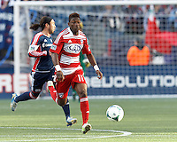 FC Dallas defender Fabian Castillo (11) brings the ball forward. .  In a Major League Soccer (MLS) match, FC Dallas (red) defeated the New England Revolution (blue), 1-0, at Gillette Stadium on March 30, 2013.