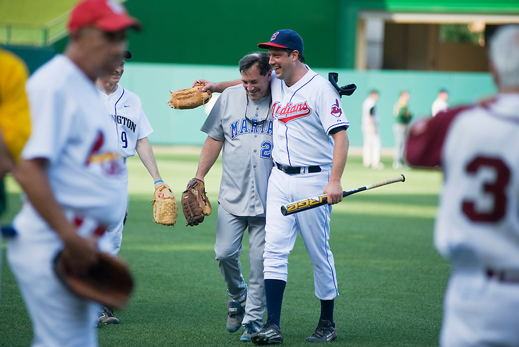 UNITED STATES - JULY 14:  Reps. Tim Ryan, D-Ohio, right and Joe Donnelly, D-Ind., leave the field after warm ups before the 50th Annual Congressional Baseball Game at Nationals Park.  The Democrats prevailed over the Republicans by the score of 8-2.  (Photo By Tom Williams/Roll Call)
