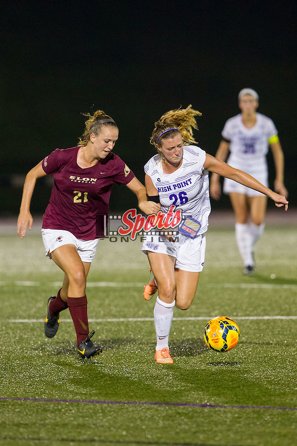 Jacky Kessler (26) of the High Point Panthers keeps the ball away from Rachel Hallman (21) of the Elon Phoenix at Vert Track, Soccer & Lacrosse Stadium on September 5, 2014 in High Point, North Carolina.  The Panthers defeated the Phoenix 3-0.   (Brian Westerholt/Sports On Film)