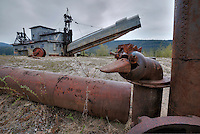 Gold dredge and pipe sculpture in the Community of Chicken, Alaska. HDR