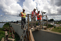 New Orleans, La.- Army Corps of Engineers staff, give a resident a tour of London Avenue Canal test project, August 17, 2007. Testing the Orleans Canal floodwalls and levees continues two years after Hurricane Katrina.  Burbank Gardens neighborhood resident Virginia Bouvier,right, is working to rebuild her destroyed home, which sits directly below the test site. Burbank Gardens is near where there was a breach in the London Avenue Canal two years ago.
