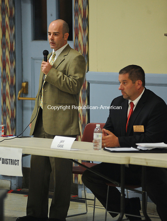 TORRINGTON, CT -11 OCTOBER 2012--101112JS05- 63rd District candidate Michael Renzullo, left, speaks as his opponent Jay Case, left, looks on during a candidate forum Thursday at St. Peter Church Hall in Torrington. The event was hosted by the Torrington Cluster of Roman Catholic parishes. .Jim Shannon Republican-American