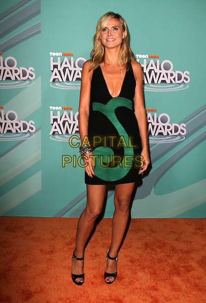 Heidi Klum (wearing Versace).The 2011 TeenNick Halo Awards held at The Hollywood Palladium in Hollywood, California, USA..October 26th, 2011.full length dress bracelets silver black green low cut neckline cleavage open toe sandals .CAP/ADM/KB.©Kevan Brooks/AdMedia/Capital Pictures.