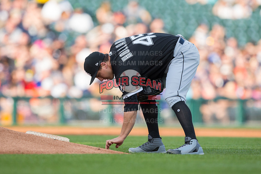 Chicago White Sox starting pitcher Derek Holland (45) writes in the dirt behind the mound during the game against the Detroit Tigers at Comerica Park on June 2, 2017 in Detroit, Michigan.  The Tigers defeated the White Sox 15-5.  (Brian Westerholt/Four Seam Images)