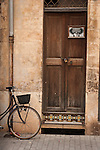 Bicycle and doorway, Llucmajor, Mallorca, Spain.