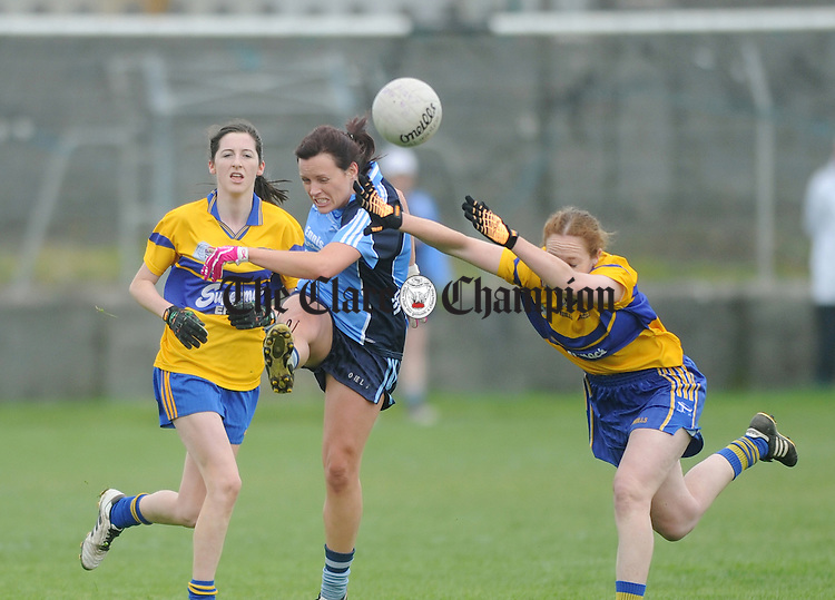 Cooraclare's Bernie Kelly clears as Louise Henchy attempts to block. Photograph by Declan Monaghan