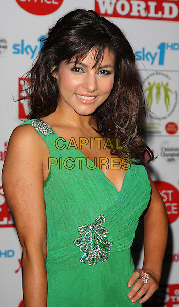 ROXANNE PALLETT .Children's Champions Awards 2009 at the Grosvenor House Hotel, Park Lane, London, England, March 4th 2009..half length green dress hand on hip bows silver bows ring  sparkly diamante .CAP/ROS.©Steve Ross/Capital Pictures