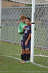 A Muncy High School goal keeper positions one of his team mates for a corner kick.