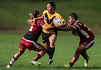 Sarina Fiso Clark of Manurewa looks to offload in the tackle of Atawhai Tupaea and Ngatokotoru Arakua of Papakura (R). Premier Women's Rugby League, Papakura Sisters v Manurewa Wahine, Prince Edward Park, Auckland, Sunday 13th August 2017. Photo: Simon Watts / www.phototek.nz
