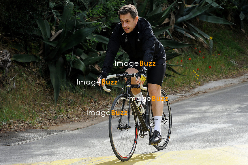 CAP NEGRE - APRIL 09:  French president Nicolas Sarkozy, riding his bike in Cavaliere, in the French Riviera, during Easter weekend holiday..