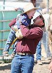 Brody Allyn of Fallon gets a lift after competing in the Pee-Wee Stick Horse Barrel race at the Fallon Junior Rodeo.  Photo by Tom Smedes.