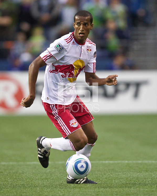 New York Red Bulls midfielder Roy Miller dribbles teh ball up field during play between the Seattle Sounders FC and the New York Red Bulls at Qwest Field in Seattle Saturday June 23, 2011. The Sounders won the game 4-2.