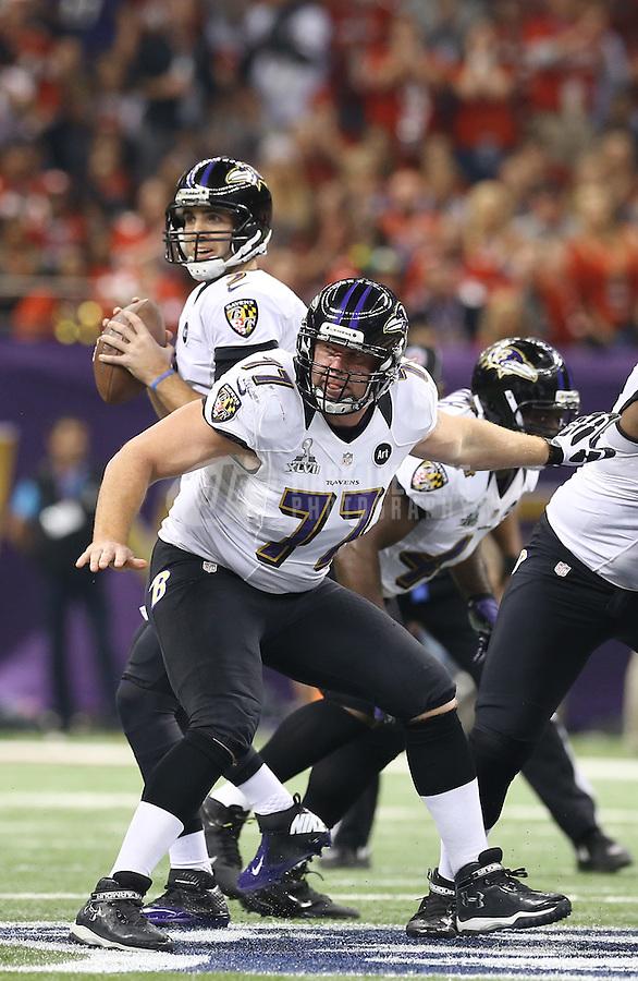 Feb 3, 2013; New Orleans, LA, USA; Baltimore Ravens center Matt Birk (77) blocks for quarterback Joe Flacco (5) against the San Francisco 49ers in Super Bowl XLVII at the Mercedes-Benz Superdome. Mandatory Credit: Mark J. Rebilas-