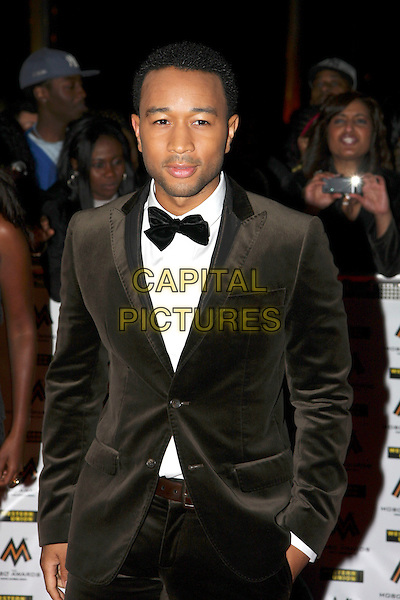 JOHN LEGEND .MOBO Awards at Wembley Arena, London, England. .October 15th, 2008 .MOBOS music of black origin half brown suit tuxedo bow tie .CAP/MAR.© Martin Harris/Capital Pictures.