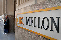 CIBC Mellon logo is seen in Toronto financial district April 19, 2010. a Joint venture between the Canadian Imperial Bank of Commerce (hereafter CIBC) and the Mellon Financial Corporation, CIBC Mellon offers asset servicing to institutional investors.