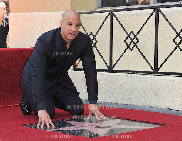 Vin Diesel on Hollywood Blvd where he was honored with the 2,504th star on the Hollwood Walk of Fame.<br /> August 26, 2013  Los Angeles, CA<br /> Picture: Paul Smith / Featureflash