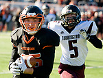 WATERTOWN, CT-112317JS07- Watertown's Joseph Deptula (45) runs in a 49-yard touchdown reception in front of Torrington's Jacob Coleman (5) during their Thanksgiving Day game Thursday at Watertown High School. <br /> Jim Shannon Republican-American