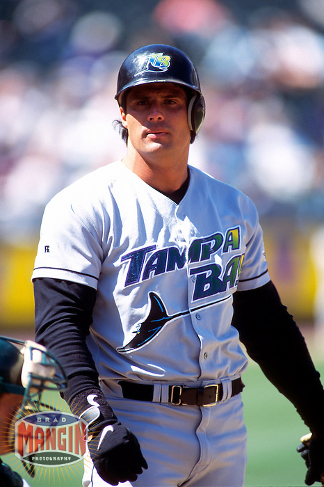 OAKLAND, CA - Jose Canseco of the Tampa Bay Devil Rays bats during a game against the Oakland Athletics at the Oakland Coliseum in Oakland, California in 1999. Photo by Brad Mangin