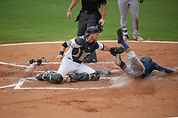 Biloxi Shuckers catcher Max McDowell (4) tags Miles Mastrobuoni (5) out while attempting to steal home during a Southern League game against the Montgomery Biscuits on May 8, 2019 at MGM Park in Biloxi, Mississippi.  Biloxi defeated Montgomery 4-2.  (Mike Janes/Four Seam Images)