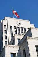 Canadian flag flying above the Art Deco style Vancouver City Hall building completed in 1936, Vancouver, British Columbia, Canada