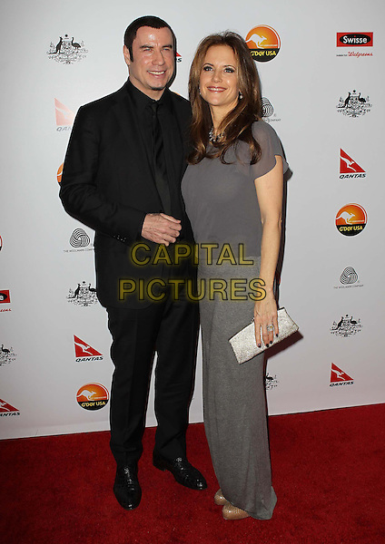 John Travolta, Kelly Preston.G'Day USA Black Tie Gala at JW Marriott, Los Angeles, California, USA..January 12th, 2013.full length  black suit grey gray top skirt clutch bag married husband wife.CAP/ADM/KB.©Kevan Brooks/AdMedia/Capital Pictures.