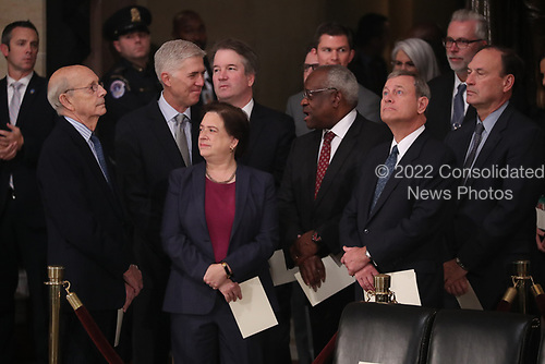 Justices of the U.S. Supreme Court including (L-R) Associate Justices Stephen Breyer, Neil Gorsuch, Elena Kagan, Brett Kavanaugh, Clarence Thomas, Chief Justice John Roberts and Associate Justice Samuel Alito await the arrival of the casket of former U.S. President George H.W. Bush inside the U.S. Capitol Rotunda, where it will lie in state in Washington, U.S., December 3, 2018. REUTERS/Jonathan Ernst/Pool