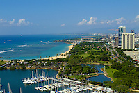 View of magic island, Ala Moana beach park and blvd. with Ala Wai boat harbor taken from above